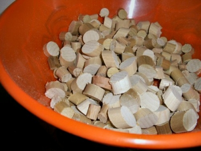 A bowl of wooden trivet buttons, multiple diameters and cut at multiple angles.
