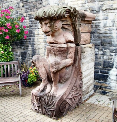 a Casa Loma Gargoyle in the flower garden terrace