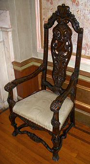 ornate wooden high-back chair at Casa Loma Castle, Toronto