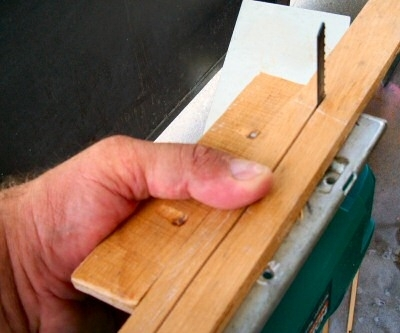 Using an electric jig-saw with a custom-made edge jig, we cut half-inch wide strips of wood from the half-inch thick hardwood stock