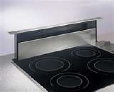 the downdraft hood usually vents through a wall or into