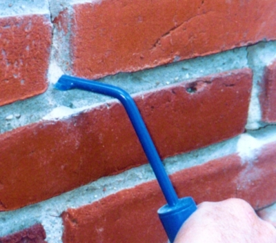 Inspecting and Repairing Fireplace Fire Brick and Mortar