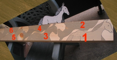 A 2X6 beam with traced designs of a horse, ready to be cut out using an electric jig saw1
