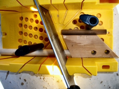 miter box cuts wooden dowel rods at desired thickness at multiple angles