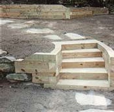 How to build a timber retaining wall - How to build a garden retaining wall ...