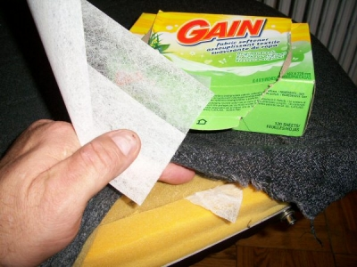 with the upholstery unhooked, stuff some fabric softener sheets under the fabric