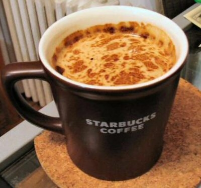 a coffee mug with the text Starbucks Coffee on the side