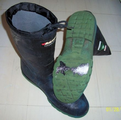 rubber work boots with exposed metal sole-plate visible