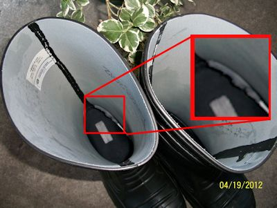 minor ployester-cloth wear damage inside of rubber boot, near heel